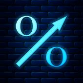 Glowing Neon Percent Up Arrow Icon Isolated On Brick Wall Background. Increasing Percentage Sign. Ve poster