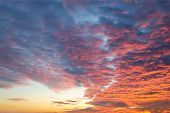 Sunset Fire In The Sky Of Natural Color. Dark Blue Clouds With Red Reflections Of The Setting Sun. S poster