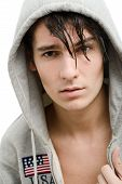 stock photo of hooded sweatshirt  - Portrait of a handsome young man in a hood - JPG