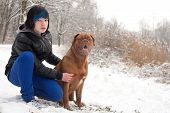 pic of emo-boy  - Funky boy is having fun with his dog in the snow - JPG