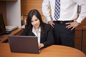 stock photo of inappropriate  - Young businesswoman being sexually harassed at work - JPG