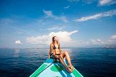 picture of bimbo  - Young sexy woman in bikini enjoying the sun on the boat - JPG