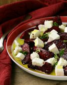 salad of roasted red beets and feta cheese with olive oil