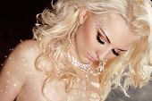 Closeup Of Blond Sexy Girl Model Wearing In Twinkled Crystals With Curly Hair And Makeup. Jewelry. B