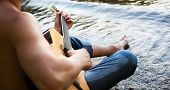 image of hillbilly  - Man and guitar on the river - JPG