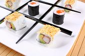 stock photo of tic-tac-toe  - Tic tac toe play with sushi and chopsticks close up - JPG