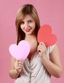 Young Woman Holding Hearts