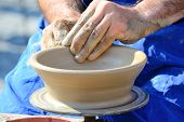 stock photo of pottery  - Potter Hands Making Pottery On A Wheel - JPG