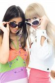 Two Beautiful Girls Trying On Sun Glasses
