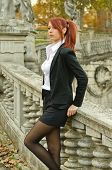 Pretty Young Woman In Business Attire Outdoors