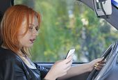 Woman Driver Sending Text Reading Message On Phone While Driving