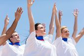 stock photo of praises  - group of Christian church choir praising and worshiping outdoors - JPG