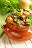 image of boeuf  - Beef stew with vegetables and herbs in a clay pot - comfort food