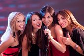 Four Beautiful Girls Singing Karaoke