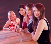 Young Ladies At A Bar Counter