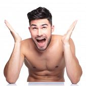 super surprised naked man looking up on white background