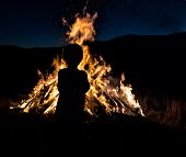 Silhouette of Boy by Bonfire
