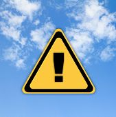 Warning Sign On Beautiful Sky Background.