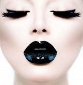 High Fashion Beauty Model Girl with Black Make up and Long Lushes. Black Lips. Dark Lipstick and Whi