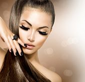 Beauty Fashion Model Girl with Long Healthy Brown Hair, Long Eyelashes. Fashion Trendy Caviar Black