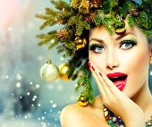Christmas Woman. Beautiful New Year and Christmas Tree Holiday Hairstyle and Make up. Beauty Girl Portrait over Winter Background. Colorful Makeup and Hair. Surprised Woman. Open Mouth, Emotions