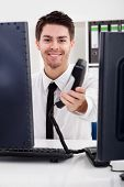 Smiling Stock Broker With Telephone