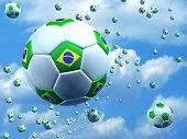 Soccer balls with Brazilian flag on the air