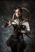 stock photo of cyborg  - Portrait of a beautiful steampunk woman over grunge background - JPG