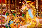 stock photo of funfair  - Traditional Carousel amusement ride found at old fashioned fairgrounds - JPG