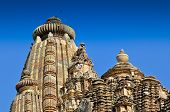Sculptors At Top Of Vishvanatha Temple, Khajuraho, India - Unesco World Heritage Site.