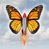 stock photo of higher power  - Creative breakthrough business metaphor as a rocket with monarch butterfly wings blasting off to higher levels of success as a symbol of the power - JPG