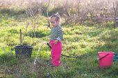 Little Girl Water In The Garden