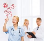 healthcare, medicine and technology concept - focused young doctor or nurse pointing to red envelope