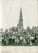 CZESTOCHOWA, POLAND - CIRCA FORTIES: Vintage photo of big group of pilgrims in front of Sanctuary of