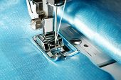 Sewing machine with blue cloth closeup