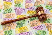 judge gavel and euro banknotes. symbolic photo for costs in court of law and auctions
