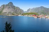 pic of reining  - Picturesque fishing town of Reine by the fjord on Lofoten islands in Norway - JPG