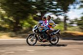 KERALA, INDIA - FEBRUARY 17: Two men riding on a bike (blurred motion). Motorbike is the most favori