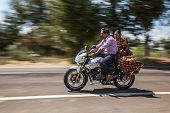 KERALA, INDIA - FEBRUARY 17: Family riding on a bike (blurred motion). Motorbike is the most favorit