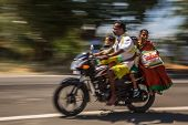 KERALA, INDIA - FEBRUARY 17: Young family riding on a bike (blurred motion). Motorbike is the most f