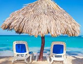Beach Chairs and Umbrella on a beautiful island in the dominican republic, punta cana