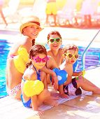 Big cheerful family having fun on beach resort, active lifestyle, spending time together near poolsi