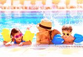 Portrait of happy cheerful family having fun in aquapark, swimming in the pool, relaxing in luxury summer resort, holidays and vacation concept