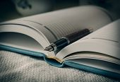 Diary and fountain pen. Macro. Selective focus.
