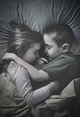 Kids Sleeping Together At Night In Bed