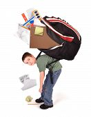 image of heavy bag  - A young child is standing with a large heavy school book bag on his back for a homework or stress concept on a white background - JPG