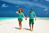Couple in green on a tropical beach at Maldives