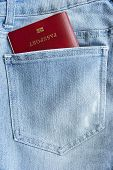picture of passport cover  - Passport in a jeans back pocket closeup - JPG