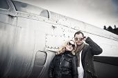 image of fighter plane  - Couple with Sunglasses in front of a fighter plane - JPG
