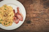 foto of scrambled eggs  - Bacon and scrambled eggs on a white plate - JPG